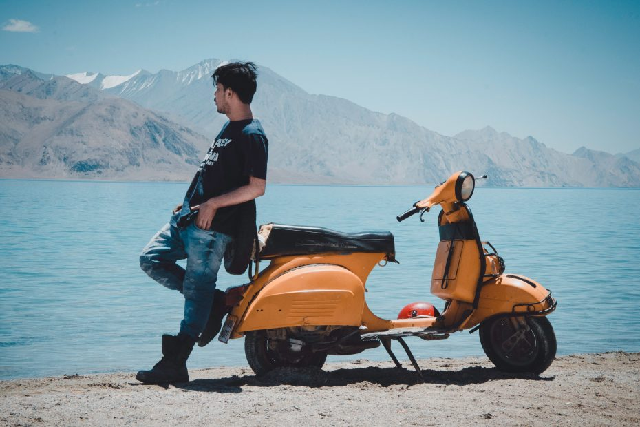 photo-of-man-leaning-on-motorcycle-1173240